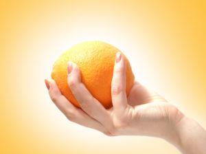 Squeeze Orange in Hand